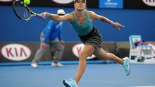 Eugenie Bouchard of Canada returns to Virginie Razzano of France during their second round match at the Australian Open tennis championship in Melbourne, Australia, Wednesday, Jan. 15, 2014. (Andrew Brownbill/AP)