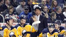 Buffalo Sabres head coach Ted Nolan watches play from behind the bench during the second period against the New York Rangers at First Niagara Center. (Kevin Hoffman/USA Today Sports)