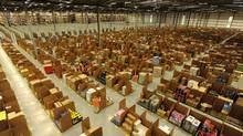 Work is carried out at Amazon's warehouse in Dunfermline, Scotland. (RUSSELL CHEYNE/REUTERS)
