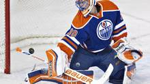 Edmonton Oilers' Ben Scrivens makes a save (JASON FRANSON/THE CANADIAN PRESS)