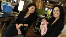Smartbrideboutique.com founders Andrea Lown, left, and Leah Andrew, with her new daughter, Ada (PETER POWER/THE GLOBE AND MAIL)