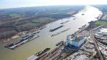 This Dec. 5, 2012 photo provided by The United States Coast Guard shows barges passing in tight quarters due to low water levels as they navigate the Mississippi River near St. Louis. (Colby Buchanan/AP)
