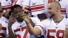 New York Giants linebacker Spencer Jacquian Williams, left, and Mark Herzlich have some fun during media day in Indianapolis. (Mark Humphrey/The Associated Press/Mark Humphrey/The Associated Press)