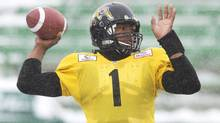 Hamilton Tiger-Cats quarterback Henry Burris throws a pass as he takes part in practice before the upcoming 101st CFL Grey Cup against the Saskatchewan Roughriders in Regina on Wednesday, Nov. 20, 2013. (Nathan Denette/THE CANADIAN PRESS)
