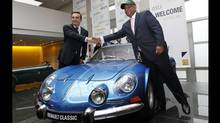Renault CEO Carlos Ghosn, left, shake hands with Caterham CEO Tony Fernandez following their joint news conference at Renault headquarters in Paris, Monday Nov. 5, 2012. (Jacques Brinon/AP)