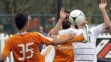 Vancouver Whitecaps midfielder Michael Manchoff takes one to the face from Houston forward Emerson Sato (35) during a soccer match at the Walt Disney World Pro Soccer Classic, Sunday, Feb. 26, 2012, in Lake Buena Vista, Fla. (AP Photo/Reinhold Matay) (Reinhold Matay/AP)