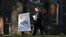 A woman makes her way to a voting station in Toronto as voters cast their ballots in the Ontario Provincial Election on Thursday October 6, 2011. (Chris Young/THE CANADIAN PRESS)