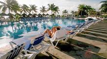 A guest sits poolside at a resort in Cancun, Mexico. There are plenty of travel rewards cards on offer, each with its own benefits and drawbacks, so choose what works for you. (TOM UHLENBROCK/St. Louis Post-Dispatch)