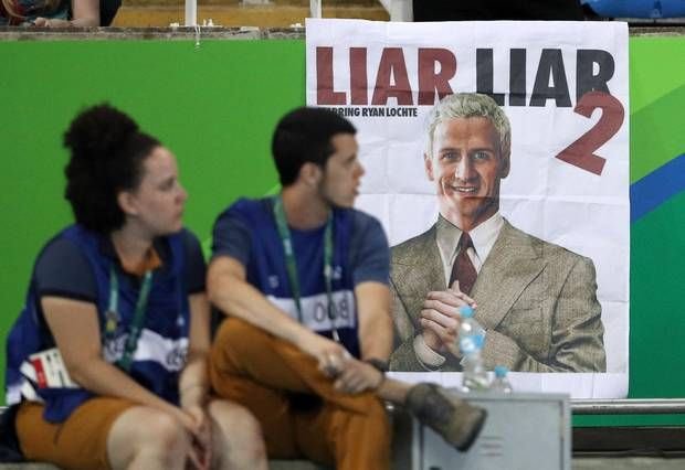 A poster poking fun at Lochte is seen at the men's decathlon final on Aug. 18 in Rio.