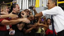 U.S. President Barack Obama shakes hands before speaking to employees at the Amazon Fulfillment Center in Chattanooga, Tenn., on July 30, 2013. (LARRY DOWNING/REUTERS)