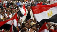 Egyptian protesters chant slogans and wave the national flags during a rally in Tahrir square in Cairo, Egypt, Friday, May 27, 2011. (Khalil Hamra/AP)