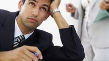 If you're bored at work, it might be time for a career wake-up call. (Stockbyte/Getty Images)