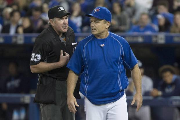 Toronto Blue Jays' Manager John Gibbons, right, has an exchange with home plate umpire Mike Winters after Jays' shortstop Troy Tulowitzki is struck out by Tampa Bay Rays' starting pitcher Drew Smyly during fourth inning Major League Baseball action in Toronto, Monday, May 16, 2016.