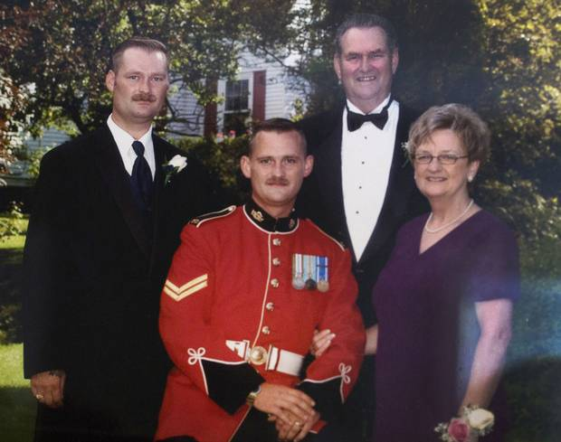 A family photo of (left to right) the late Sgt. Ron Anderson, his brother Ryan and parents Peter and Maureen. Sgt. Ron Anderson died by suicide in February, 2014. His brother Ryan is also a member of the military and being treated for PTSD.