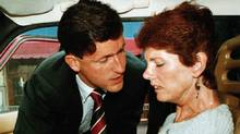 Sue Rodriguez is consoled by NDP MP Svend Robinson in 1993 after the Supreme Court of Canada turned down her plea for a doctor-assisted suicide. (Jeff Vinnick/Reuters)