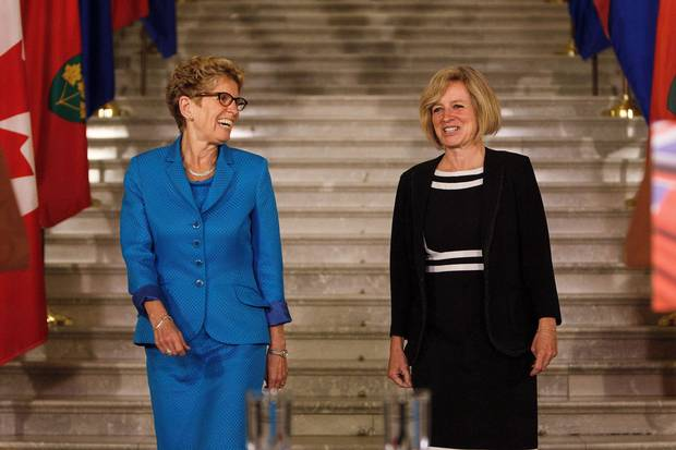 Ontario Premier Kathleen Wynne, left, and Alberta Premier Rachel Notley hold a media availability at the Alberta Legislature on May 26, 2016.