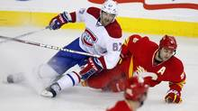 Montreal Canadiens' Max Pacioretty, left, crashes down on Calgary Flames' Mark Giordano during second period action in Calgary March 6, 2012. (Jeff McIntosh/The Canadian Press/Jeff McIntosh/The Canadian Press)