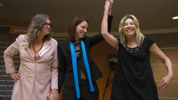 Linda McQuaig, right, stands next to opponents Jennifer Hollett, centre, and Susan Gapka, left, as she reacts to winning the NDP nomination in the by-election for Toronto Centre on Sept. 15, 2013. (Michelle Siu for The Globe and Mail)
