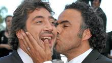 Director Alejandro Gonzalez Inarritu kisses actor Javier Bardem at the premiere of Biutiful, May 17, 2010 in Cannes. (Pascal Le Segretain/Pascal Le Segretain/Getty Images)