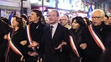 Paris Mayor Bertrand Delanoe, centre, and Deputy Mayor Anne Hidalgo, second right, participate in a mass silent march in Paris to pay tribute to the four victims killed by a gunman at a Jewish school in Toulouse, on March 19, 2012. (Charles Platiau/Reuters/Charles Platiau/Reuters)