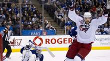 Columbus Blue Jackets forward Rick Nash celebrates his teammates goal past Toronto Maple Leafs goalie Jonas Gustavsson in Toronto, Dec. 30, 2010. (Nathan Denette/The Canadian Press/Nathan Denette/The Canadian Press)