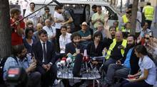 Members of Spain's 'Indignados' movement hold a news conference after filing a lawsuit against Bankia bank in Madrid June 14, 2012. (ANDREA COMAS/REUTERS)