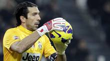 Juventus' goalkeeper Gianluigi Buffon holds the ball during their Italian Serie A soccer match against SS Lazio at the Juventus stadium in Turin November 17, 2012. (ALESSANDRO GAROFALO/REUTERS)