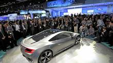 The Acura NSX hybrid concept car is shown to members of the media Monday at North American International Auto Show in Detroit. (MIKE CASSESE/REUTERS)