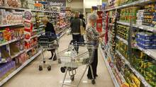 Customers shop for groceries in a supermarket in London. (STRINGER/UK/Reuters)