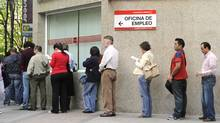 People wait in line at a government employment office in the centre of Madrid. (DOMINIQUE FAGET/AFP/Getty Images)