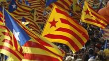 Marchers wave Catalonian nationalist flags as they demonstrate during Catalan National Day in Barcelona, Sept. 11, 2012. (GUSTAU NACARINO/REUTERS)
