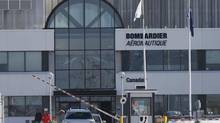 Employees leave work at a Bombardier plant in Montreal, January 21, 2014. Canada's Bombardier Inc said on Tuesday it will cut 1,700 aerospace jobs. (CHRISTINNE MUSCHI/REUTERS)