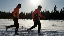 Bill Anderson, left, and Gail Teed run along a snowmobile trail in Rothesay, NB on Thursday, February 17, 2011 (David Smith-MDS Photography/David Smith-MDS Photography)