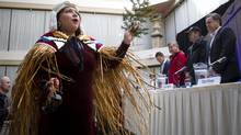 A traditional first nations dancer opens the press conference of Eagle Spirit Energy Holdings Ltd., and the Aquilini Group announcing their plan to lead a First-Nations headed alternative pipeline to Enbridge's Northern Gateway Pipeline proposal in Vancouver, British Columbia on April 14, 2014. (Ben Nelms For The Globe and Mail)