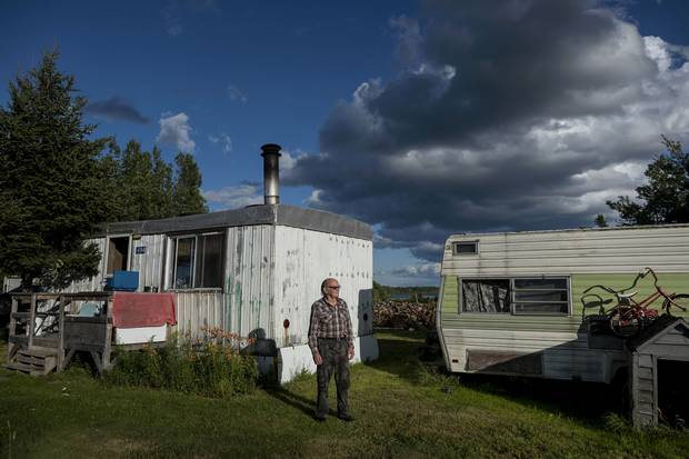 Jackie Vautour in front of his shack in Kouchibouguac National Park.