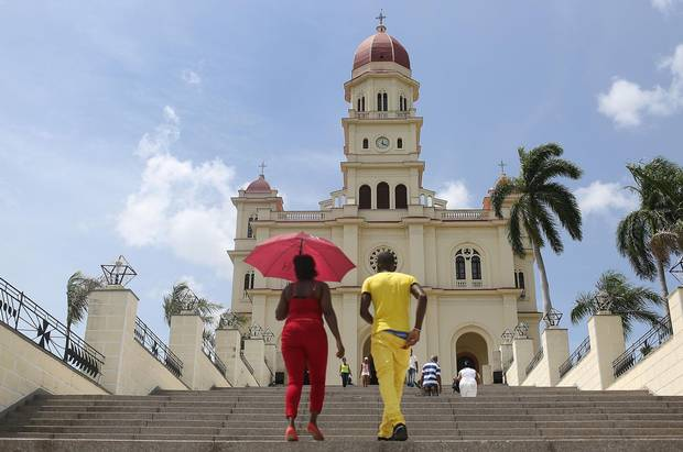 Visitors climb the stairs to the El Cobre church where the Pope attended mass on his visit to Cuba.