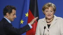 French President Nicolas Sarkozy and German Chancellor Angela Merkel (THIERRY ROGE)