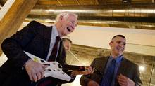 Governor-General David Johnston uses a guitar-shaped game controller to play an educational science game during a visit to Spongelab Interactive in Toronto on March 14, 2012. He is being assisted by Ed Hitchcock, who is a teacher in Toronto. (Peter Power/Peter Power/The Globe and Mail)
