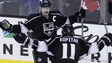Los Angeles Kings' Dustin Brown (top) celebrates his empty net goal with teamm