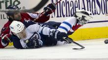Washington Capitals defenseman Roman Hamrlik, top, fights with Winnipeg Jets right wing Antti Miettinen for the puck during the second period of an NHL hockey game on Friday, March 23, 2012, in Washington. (Evan Vucci/AP)