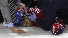 Montreal Canadiens left wing Max Pacioretty is treated as he lies on the ice after being hit by Boston Bruins defenseman Zdeno Chara in a 2011 game. (SHAUN BEST/REUTERS)