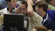 Traders react in the Corn Options Pit at the CME group in Chicago July 11, 2012, after the U.S. Department of Agriculture (USDA) updated its crop production, ending stocks and world supply/demand forecast. (JOHN GRESS/REUTERS)
