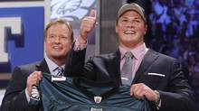 Baylor guard Danny Watkins poses for photographs with NFL commissioner Roger Goodell after he was selected as the 23rd overall pick by the Philadelphia Eagles in the first round of the NFL football draft at Radio City Music Hall on Thursday, April 28, 2011, in New York. (Jason DeCrow/AP)