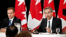 MInister of Natural Resources Joe Oliver, right, and Patrick Lamarre, CEO of SNC-Lavalin Nuclear, announce SNC-Lavalin's acquisition of the CANDU reactor division of AECL Ltd. (Della Rollins For The Globe and Mail)