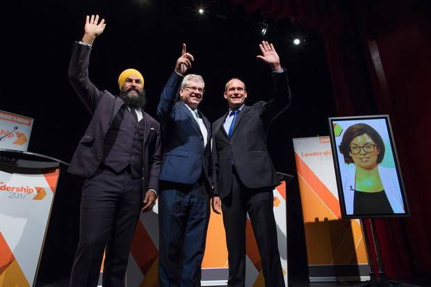 Jagmeet Singh, Charlie Angus and Guy Caron pose for a photograph as Niki Ashton appears via satellite from Ottawa before the final federal NDP leadership debate in Vancouver on Sept. 10, 2017.