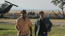 Denzel Washington, left, and Mark Wahlberg star in the action-comedy 2 Guns. (The Canadian Press)