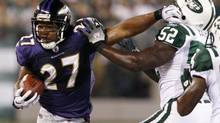 Baltimore Ravens' running back Ray Rice (L) runs past New York Jets' David Harris (R) in the first half in their NFL football game in East Rutherford, New Jersey, September 13, 2010. (MIKE SEGAR/REUTERS)