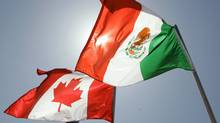 The flags of Canada and Mexico. (AP Photo/Judi Bottoni) (Judi Bottoni/AP)