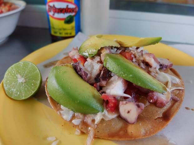 Tostadas de pulpo, fried corn tortillas topped with marinated octopus, fresh salsa and avocado, are a common sight in Mexico City.