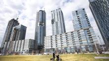 Pedestrians are seen in a park at the City Place condo development in Toronto, Ont. March 15/2012. (Kevin Van Paassen/Kevin Van Paassen)
